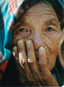 64-BEST NEPAL-BHUTAN-OLD WOMAN WITH HAND TO FACE AND NOSERIN